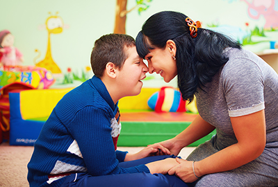 soulful moment. portrait of mother and her beloved son with disability in rehabilitation center